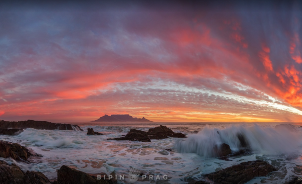 A fiery autumn sun sets in Cape Town