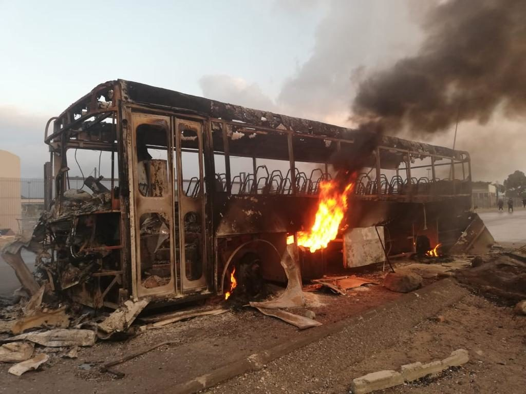 Bus torched during protest