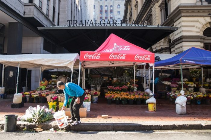 Generations of Cape Town flower traders cut it in the city market