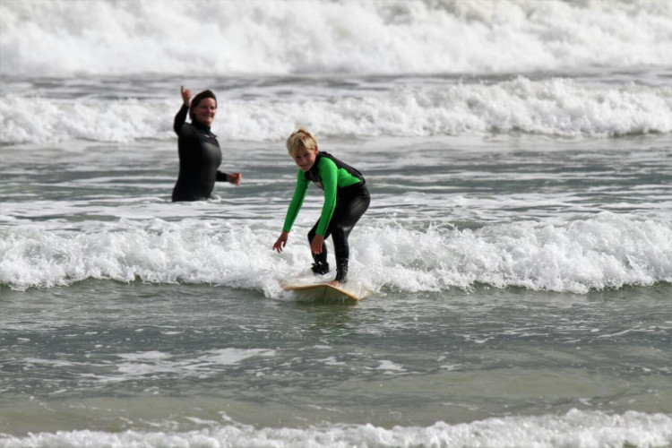 Young surfer raises thousands for underprivileged