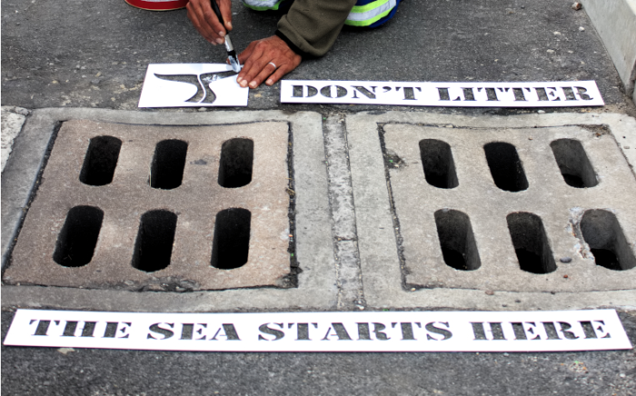 'Don't litter' signs painted on Gansbaai drains