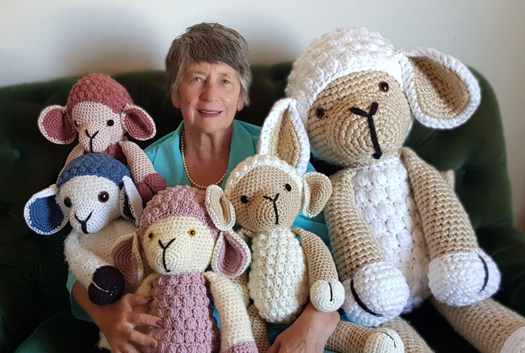 Elderly woman crochets sheep for drought relief
