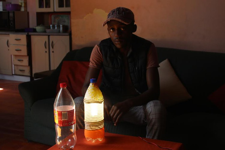 Cape man upcycles plastic bottles for study lamps