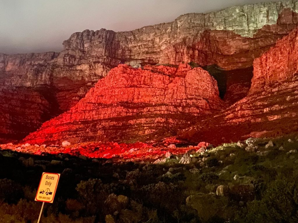Table Mountain glows red for SA protest