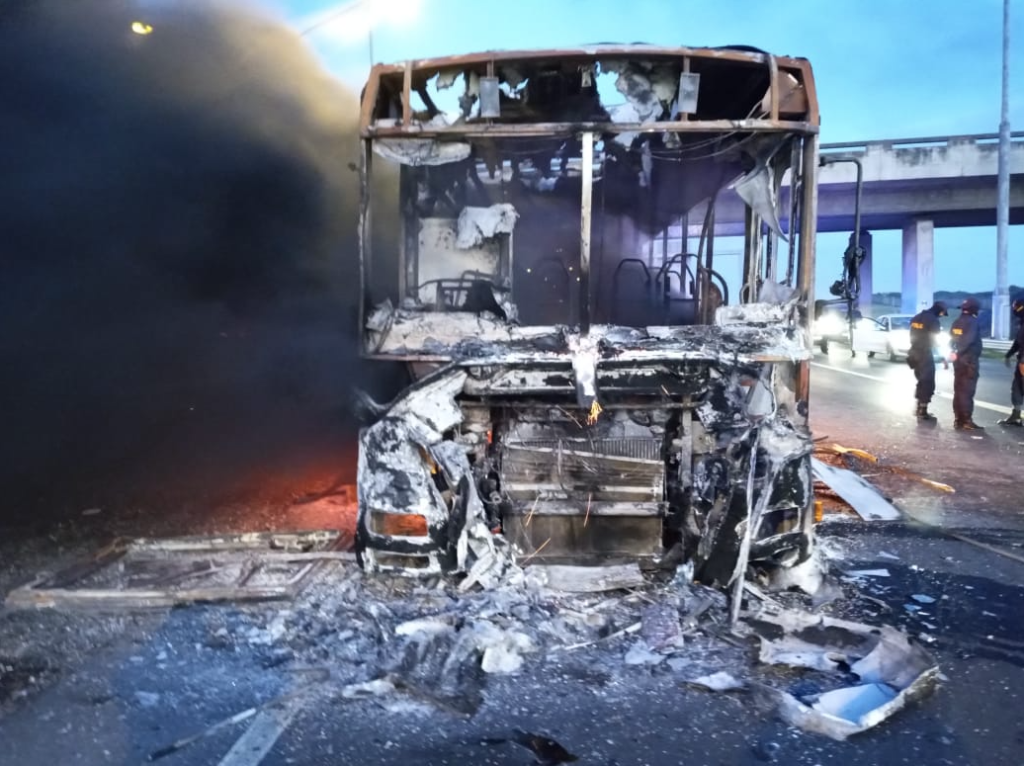 Buses set alight during protest action near Delft