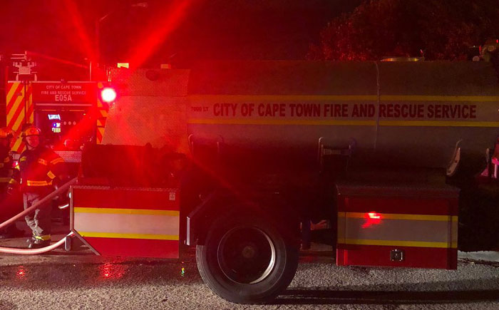 Strand coupled killed in fire, child escapes unharmed