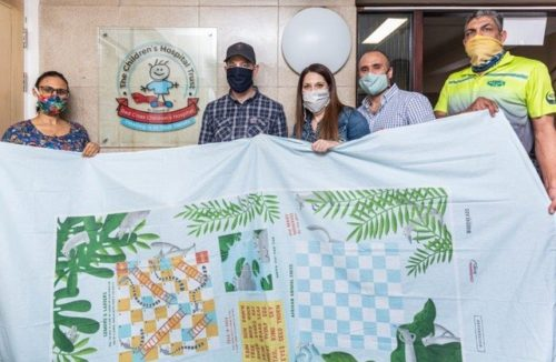 Fair Cape Cares Foundation donate board game bed sheets to Red Cross War Memorial Children's Hospital