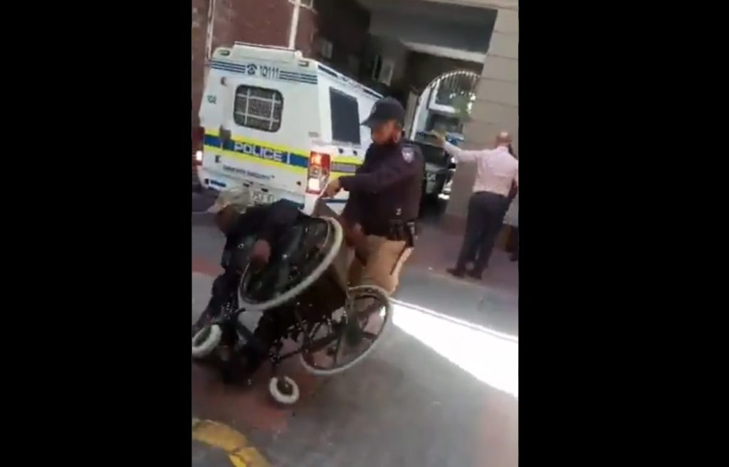 Two metro police suspended for throwing disabled man from wheelchair