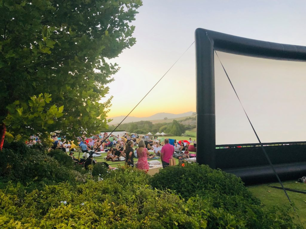Enjoy an outdoor movie night on a Cape wine farm
