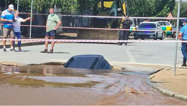 Vehicle carrying father and son plunges into a sinkhole