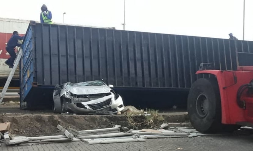 Two cars crushed after strong winds blow over Goods Containers