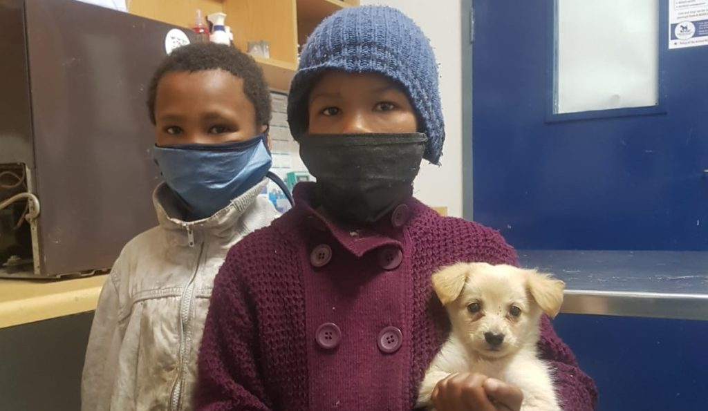 Two young girls sacrifice their last packet of chips to help puppy
