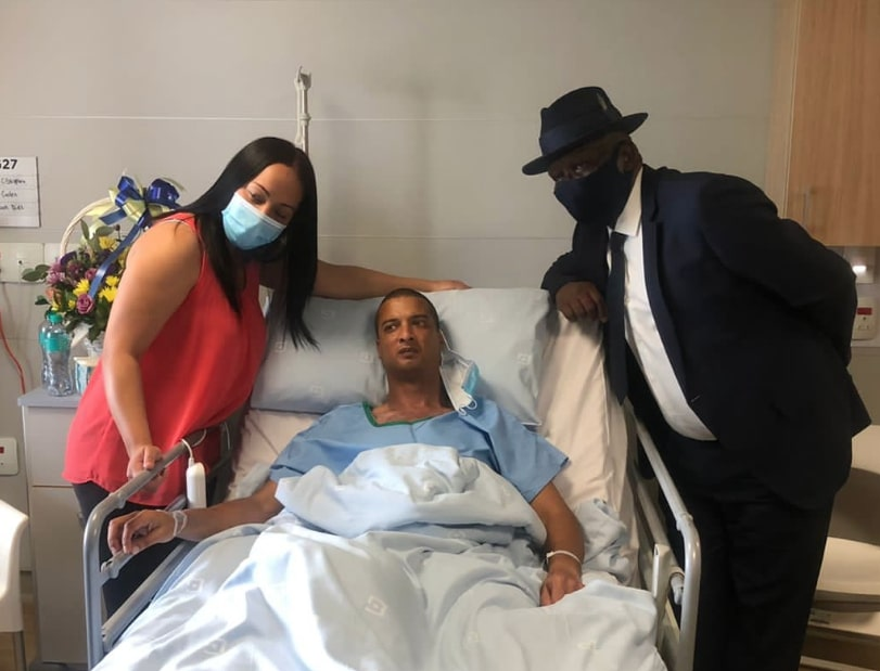 Police minister visits wounded officer in hospital