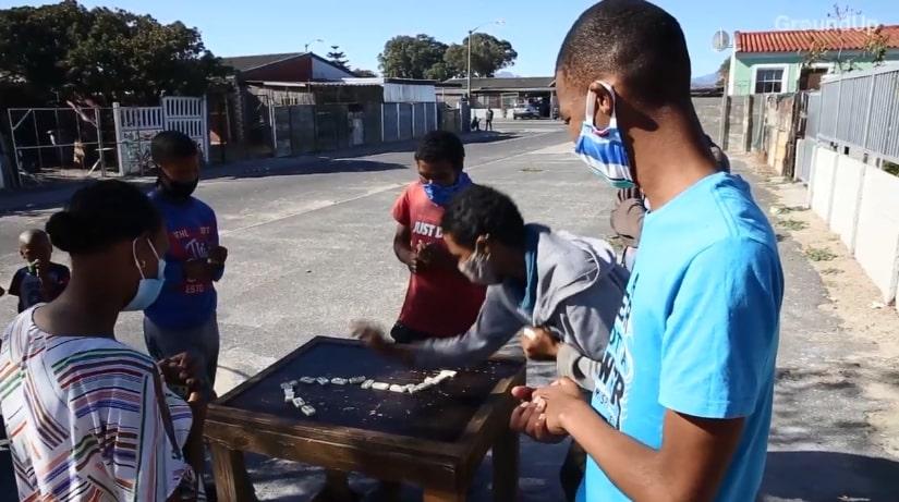 An after school dominoes club in Belhar, Cape Town