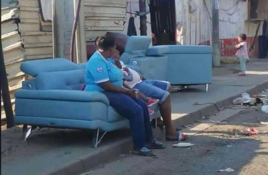 The famous looted blue couch didn't make it sofa...FOUND!