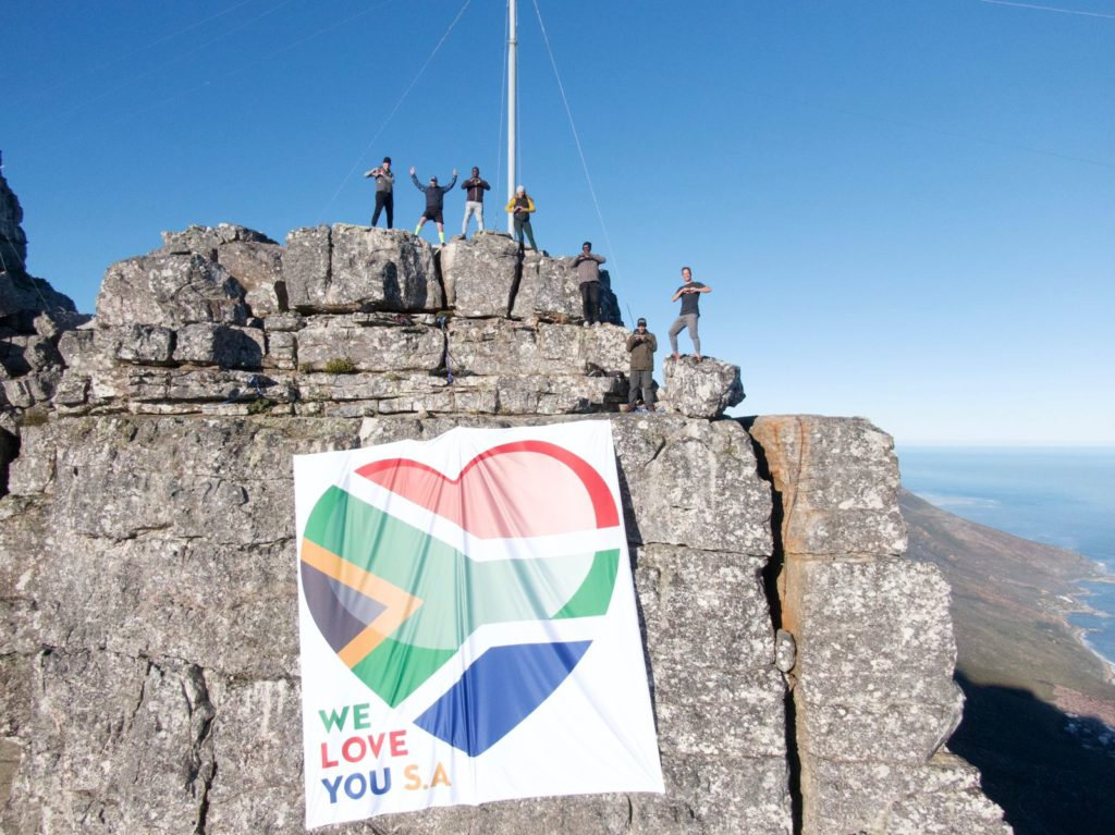 Proudly South African banner gently rests on iconic Table Mountain