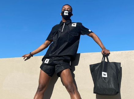Creative turns Woolworths bags into an outfit