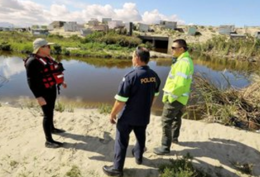 Police divers continue their search for the bodies of three missing young men in Driftsands
