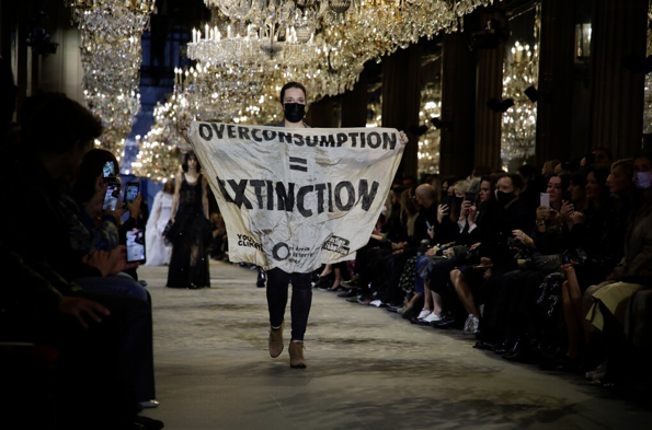 Why the Louis Vuitton runway was stormed by a protestor